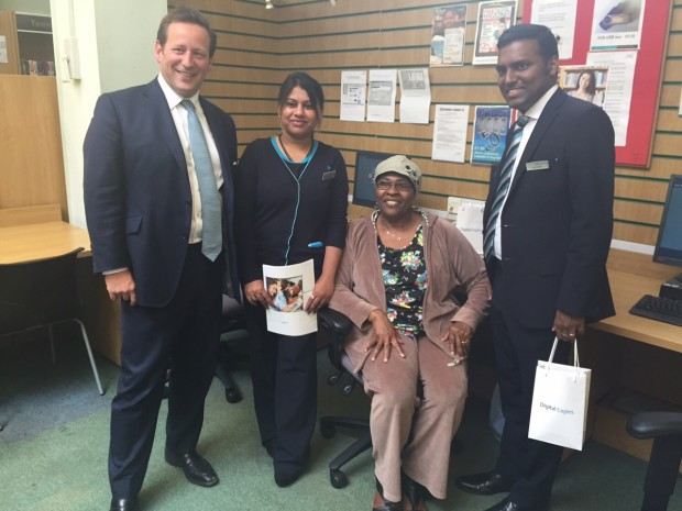 Ed Vaizey, Minister of State for Culture and the Digital Economy, at Nunhead Library in south London with Barclays Digital Eagles Prasanna Kousalya (l) and Jitto Chittapalli (r) and Folashade Okon (seated).